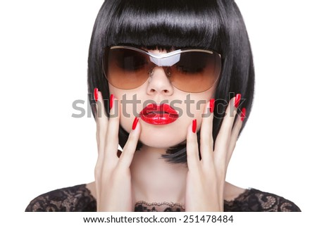 Red Lips Makeup and manicured polish nails. Fashion brunette woman wearing in sunglasses isolated on white background. Long Fringe.  - stock photo