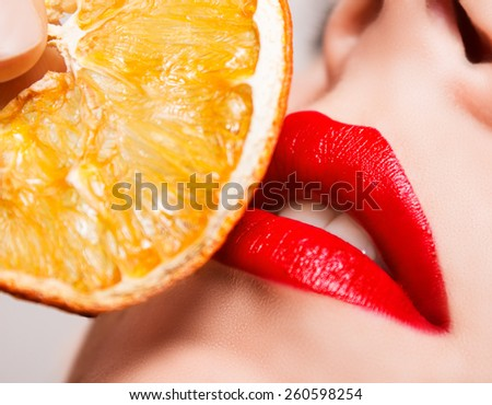 red lips touch the orange - stock photo