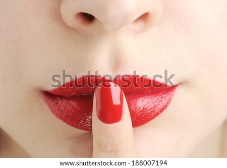 red lips with finger do silence - stock photo