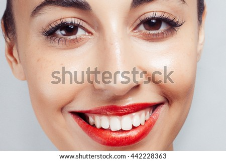red lipstick and white teeth. woman with white teeth and red lips