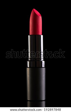 Red lipstick isolated on black background - stock photo