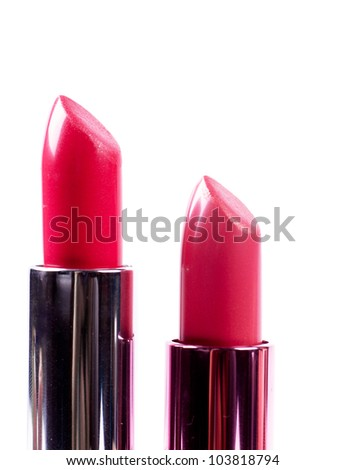 Red lipsticks isolated over white background