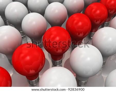 Red lits light bulb amongst other broken light bulbs - stock photo