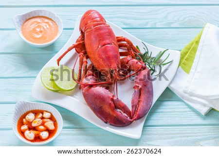 Red lobster on blue table - stock photo