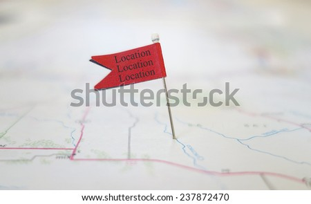 Red locator flag on a map with Location Location Location text                               - stock photo