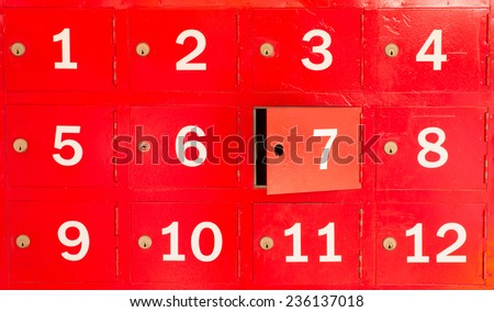 red locker with number in front of box - stock photo