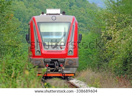 Red locomotive in nature  closeups - stock photo