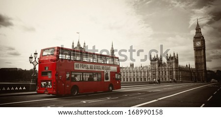 Red London Bus in front of Big Ben - stock photo