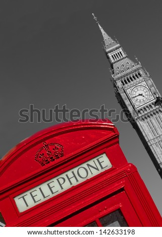 Red London phone box with black and white Big Ben in the background.