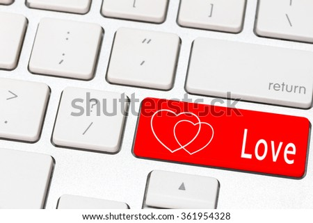 Red love and heart button on the keyboard , valentine concept - stock photo