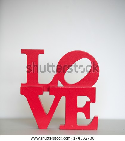 Red love lettering. - stock photo