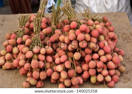 Red lychee bunch sell in market, Thailand. - stock photo