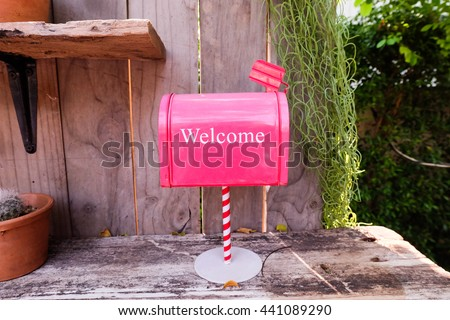 Red Mail Box in garden. - stock photo