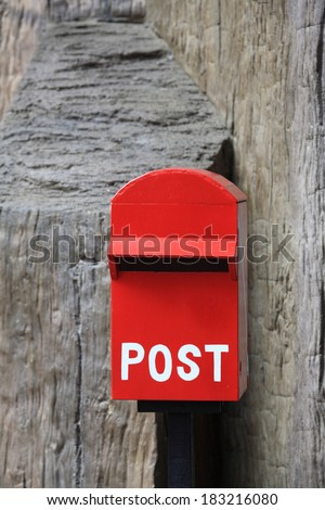 Red mail box on the wall - stock photo