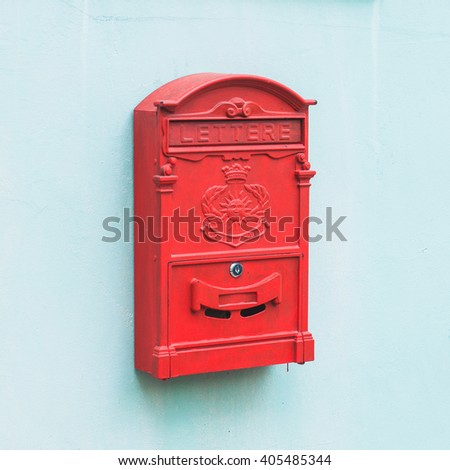 red mailbox on blue wall background