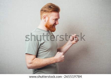 red man with his fists - stock photo
