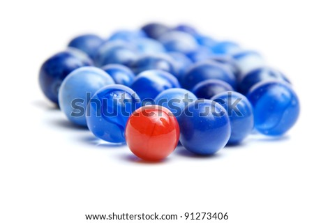 Red marble standing out in a crowd of blue marbles