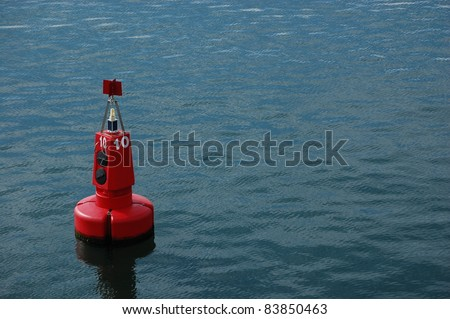 Red Marker Buoy in Sea. - stock photo