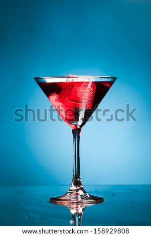 red martini cocktail, blue background