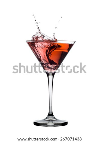 red martini cocktail splashing in glass isolated on white  - stock photo