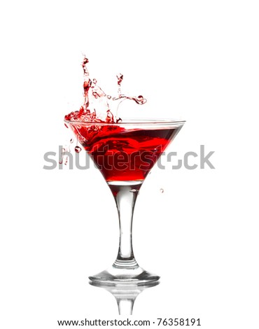 red martini cocktail splashing into glass isolated on white background - stock photo