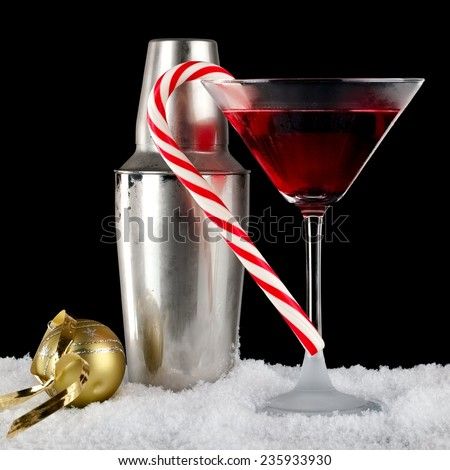 Red martini with Xmas lollipop and frozen shaker - stock photo