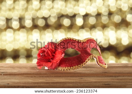 red mask of carnival on wooden top  - stock photo