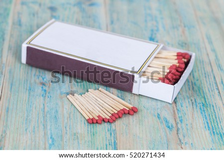 Red Matchbox on color wood background