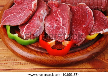 red meat on wooden table ready to cook - stock photo
