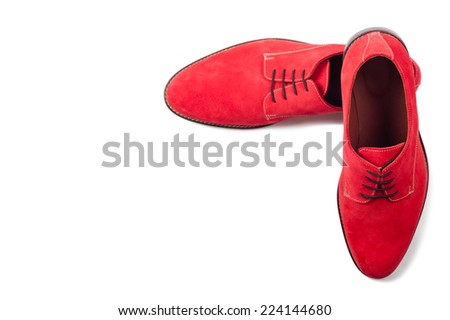 Red men suede shoes isolated on white background top view - stock photo