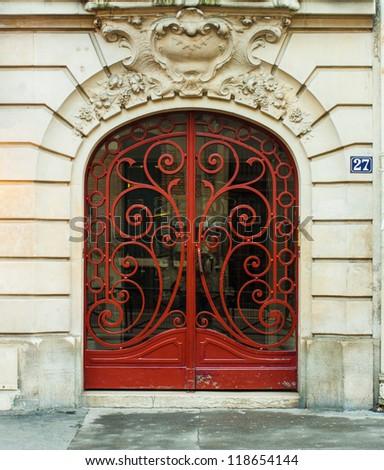 Red Metal Door in Paris, France (Art Nouveau style) - stock photo