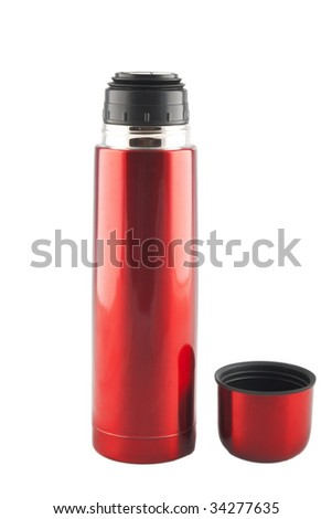 red metal thermos  with cup nearby - stock photo