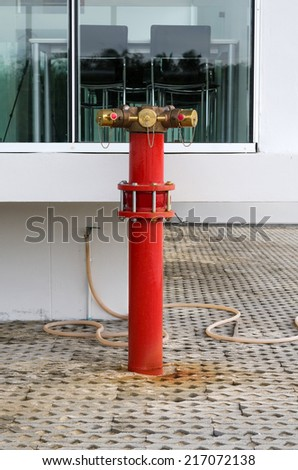 Red metallic fire hydrant or Fire Department Connection on street  - stock photo