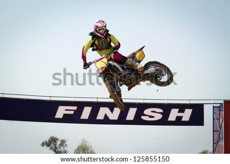 Red Motocross winner jump