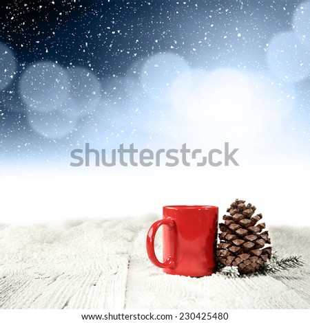 red mug and cone  - stock photo