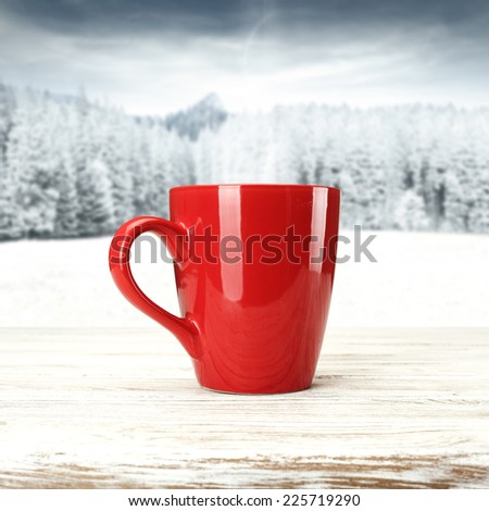 red mug of coffee and snow  - stock photo