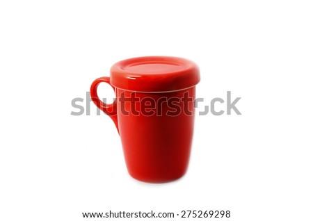 red mug on a white background - stock photo