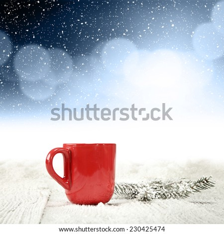 red mug tree of green and frost  - stock photo