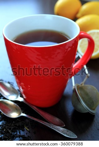 Red mug with hot tea