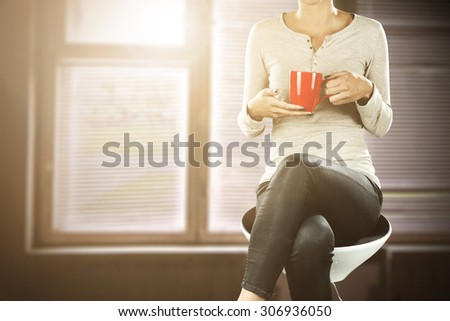 red mug woman and summer sun light in window  - stock photo