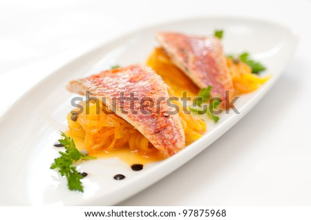 Red mullet with mango, papaya and green pepper - stock photo
