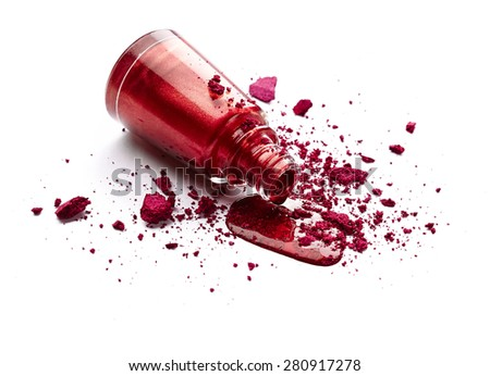 Red nail polish and crushed eye shadow isolated on white background