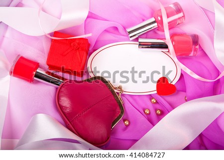 Red nail polish and female red purse