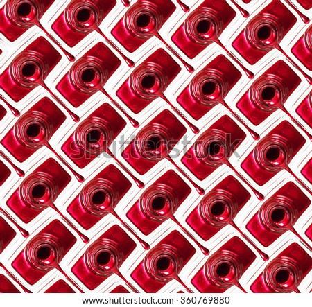 Red nail polish background. - stock photo