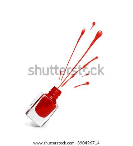 red nail polish bottle with splash isolated on white - stock photo