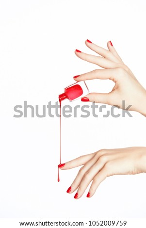 Red Nail Polish Hand With Nails On White Background Close Up Of Female