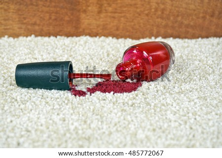 red nail polish spill on light colored carpet