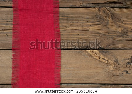 Red Natural Fabric Place Mat As Texture With Copy Space On Wooden Background With Country Style