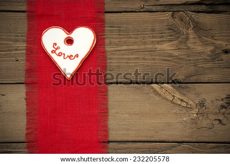 Red Natural Fabric Place Mat As Texture With Copy Space On Wooden Background With Country Style And A Heart Cookie With Love