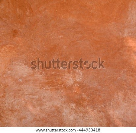 Red natural wall texture of cob house for background. It is a natural building material made from subsoil, water and straw fibrous organic material.